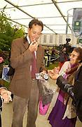 "Richard E. Grant eating 'stinking toe"" Chelsea Flower Show. 19 May 2003. © Copyright Photograph by Dafydd Jones 66 Stockwell Park Rd. London SW9 0DA Tel 020 7733 0108 www.dafjones.com"