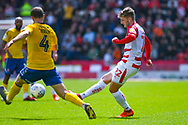 Kieran Sadlier of Doncaster Rovers (22) passes the ball during the EFL Sky Bet League 1 play off first leg match between Doncaster Rovers and Charlton Athletic at the Keepmoat Stadium, Doncaster, England on 12 May 2019.