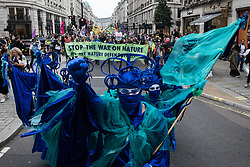 London, UK. 4th September, 2021. Extinction Rebellion Blue Rebels take part in a colourful March for Nature on the final day of their two-week Impossible Rebellion. Extinction Rebellion are calling on the UK government to cease all new fossil fuel investment with immediate effect.