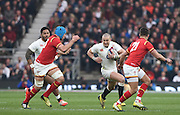Twickenham. Great Britain.<br /> Mike running with the ball as left Justin TIPURIC and Right, Rhyes WEBB set themselves for the interception, during the <br /> RBS Six Nations Rugby, England vs Wales at the RFU Twickenham Stadium. England.<br /> <br /> Saturday  12/03/2016 <br /> <br /> [Mandatory Credit; Peter Spurrier/Intersport-images]