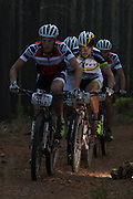 Philip Buys of Team SCOTT-Odlo MTB racing looks past Matthys Beukes of SCOTT Factory Racing during stage 6 of the 2014 Absa Cape Epic Mountain Bike stage race from Oak Valley Wine Estate in Elgin, South Africa on the 29 March 2014<br /> <br /> Photo by Greg Beadle/Cape Epic/SPORTZPICS