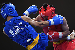 JAKARTA, Aug. 19, 2018  Kan Kai Wa (R) of China's Macao competes with Jason Goh of Singapore during Men's Sanda-56kg Round of 32 in the 18th Asian Games in Jakarta, Indonesia, Aug. 19, 2018. Kan Kai Wa won 2-0. (Credit Image: © Pan Yulong/Xinhua via ZUMA Wire)