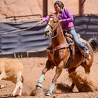 Kadin Jodie lassos her calf in breakaway roping during the Jr High School Finals rodeo Friday at Red Rock Park in Gallup.