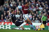 Photo: Rich Eaton.<br /> <br /> Aston Villa v West Ham. The Barclays Premiership. 03/02/2007. John Carew of Aston Villa right gets past West Hams Calum Davenport