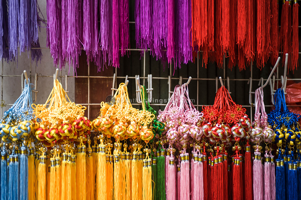 Close up view of colorful  tassels at a shop in Yangshuo, China.