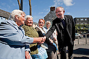 Bishop Elect Kieran O'Reilly is greeted by Maureen Quinn,Mary Burke,Kathleen Kearney and Sr Kathleen Cleary as he arrived for a press conference at Ennis Cathedral to introduce the new Bishop of Killaloe ahead of his Ordination on 29th August. Photograph by Eamon Ward (Gordon Deegan is sending copy)