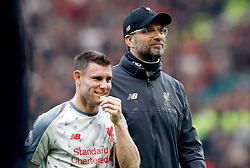 Liverpool manager Jurgen Klopp (right) and James Milner at the end of the Premier League match at Old Trafford, Manchester.