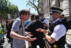 © Licensed to London News Pictures. 14/06/2021. London, UK. Anti Lockdown and anti Covid vaccination protesters take part in a demonstration outside Downing Street. Later today the British Prime Minister will hold a press conference and announce his decision on lockdown easing. Photo credit: Ray Tang/LNP