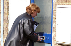 Council Housing Management staff issuing notices to tenants about need to report acts of anti-social behaviour, fly-tipping etc. North Tyneside. UK