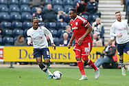 Kagisho Dikgacoi of Cardiff City looks to pass under pressure from Daniel Johnson of Preston North End. Skybet football league championship match, Preston North End v Cardiff City at the Deepdale stadium in Preston, Lancashire on Saturday 17th October 2105.<br /> pic by Chris Stading, Andrew Orchard sports photography.