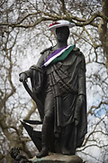 A suffragette-style sash has been draped by a womens group across the statue of Francis, Duke of Bedford on International Womens Day, on 8th March 2018, in Russell Square, London, England. According to the group concerned about the poor representation of women commemorations, there are fewer than 3% of non-royal statues in the UK. Francis Russell, 5th Duke of Bedford 1765-1802 was an English aristocrat and Whig politician, responsible for much of the development of central Bloomsbury, London.