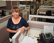 Houston ISD Information Technology Specialist Maria Moreno poses for a photograph at the Help Desk office, May 20, 2014.