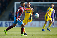 Scunthorpe United midfielder Funso Ojo (6) goes past Wimbledon Shane McLoughlin (38)  during the EFL Sky Bet League 1 match between Scunthorpe United and AFC Wimbledon at Glanford Park, Scunthorpe, England on 30 March 2019.
