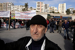 Protesters outside the Greek Maritime ministry. Maritime workers stage a rally, amid a 48h strike at Piraeus port near Athens, Greece on Monday December 5, 2016. Seamen and maritime workers marched to the Shipping Ministry protesting planned reforms in taxation and social insurance system. Photo by Panayotis Tzamaros/ABACAPRESS.COM