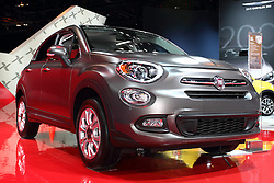 """12 February 2015:  2016 FIAT 500X: On display at the 107th annual Chicago Auto Show, Feb.14-22, 2015, is the all-new 2016 Fiat 500X, the latest addition to the Fiat lineup in North America.  Arriving in the second quarter of 2015, the Fiat 500X crossover blends genuine Italian design with advanced all-wheel drive system, unmatched functionality, and performance. The 2016 Fiat 500X is available in five trim levels: Pop, Easy, Lounge, and for a more rugged look, Trekking and Trekking Plus.  On the exterior, design elements like double headlamps, a trapezoidal nose, the signature """"whiskers and logo"""" face and the rounded clamshell hood pay homage to the original Cinquecento. You'll notice the Trekking and Trekking Plus models due to the unique front and rear fascia designs, and satin silver accents. The purposeful and distinct design carries through to the five-passenger interior with clever storage, body-color instrument panel, a circular cluster display and iconic door handles. Loaded with technology and convenience, the Fiat 500X is available with features like Uconnect 6.5 radio with a 6.5-inch high-resolution touchscreen and navigation, Bluetooth streaming audio, Uconnect Access Via Mobile, a 3.5-inch color thin-film transistor (TFT) cluster display, Keyless Enter-N-Go, and heated front seats and steering wheel. Buyers have their choice of the fuel-efficient, 160-horsepower 1.4-liter MultiAir Turbo engine paired with a six-speed manual transmission, or the 2.4-liter Tigershark MultiAir2 engine that produces 180 horsepower, and is paired exclusively to a nine-speed automatic transmission on all-wheel-drive and front-wheel-drive models. Interesting exterior color choices include Arancio (orange), Rosso Passione (Red Hypnotique clear coat), Verde Toscana (green metallic) and Blu Venezia (Blue metallic).<br /> <br /> First staged in 1901, the Chicago Auto Show is the largest auto show in North America and has been held more times than any other auto exposition on the c"""