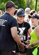 Middletown, New York - Runners talk before the start of the 15th annual Ruthie Dino Marshall 5K Run and Fun Walk hosted by the Middletown YMCA on Sunday, June 5,  2011.