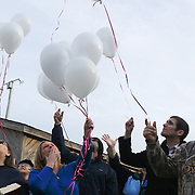 Friends and family of Randy Hockabout release balloons at  a ceremony to remember Hockabout's life at Optimist Park, where his body was found on January 25, 1986. The homicide has remained unsolved and Hockabout's family have launched new efforts to solve the crime including using facebook to find leads. (Jason A. Frizzelle)