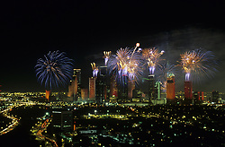 Aerial view of the downtown Houston, Texas skyline with Power of Houston fireworks at night.