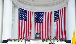 United States President Barack Obama makes remarks in the Memorial Amphitheater at Arlington National Cemetery in Arlington, Virginia after laying a wreath at the Tomb of the Unknown Soldier on Veteran's Day, Friday, November 11, 2016.<br /> Credit: Ron Sachs / Pool via CNP