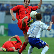 Belgium's Jacky Peters tangles with Hidetoshi Nakata