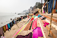 Washing drying on ghats next to the River Ganges, Varanasi, Uttar Pradesh, India
