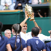 LONDON, ENGLAND - JULY 16: Roger Federer of Switzerland leaves center court with a line of honor from the ball boys and ball girls after winning the Gentlemen's Singles final of the Wimbledon Lawn Tennis Championships at the All England Lawn Tennis and Croquet Club at Wimbledon on July 16, 2017 in London, England. (Photo by Tim Clayton/Corbis via Getty Images)