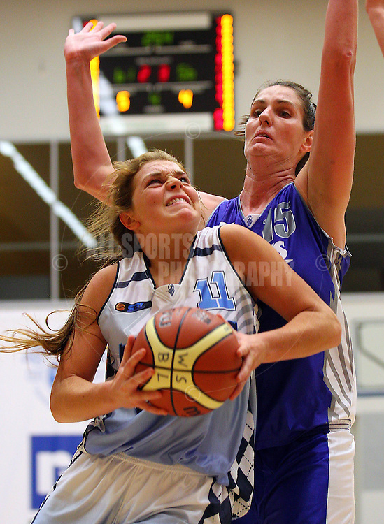 PERTH, AUSTRALIA - JULY 16: Jasmine Hooper of the Tigers drives to the basket against Christine Boyd of the Hawks during the week 18 SBL game between the Perry Lakes Hawks and the Willetton TIgers at The State Basketball Center on July 16, 2011 in Perth, Australia.  (Photo by Paul Kane/Allsports Photography)