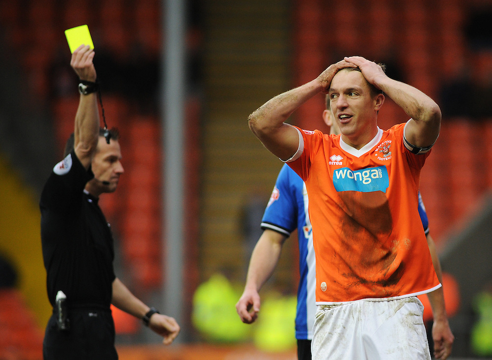 Blackpool's Anthony McMahon can't believe it as he's shown a yellow card for diving<br /> <br /> Photographer Kevin Barnes/CameraSport<br /> <br /> Football - The Football League Sky Bet Championship - Blackpool v Wigan Athletic - Saturday 28th February 2015 - Bloomfield Road - Blackpool<br /> <br /> © CameraSport - 43 Linden Ave. Countesthorpe. Leicester. England. LE8 5PG - Tel: +44 (0) 116 277 4147 - admin@camerasport.com - www.camerasport.com