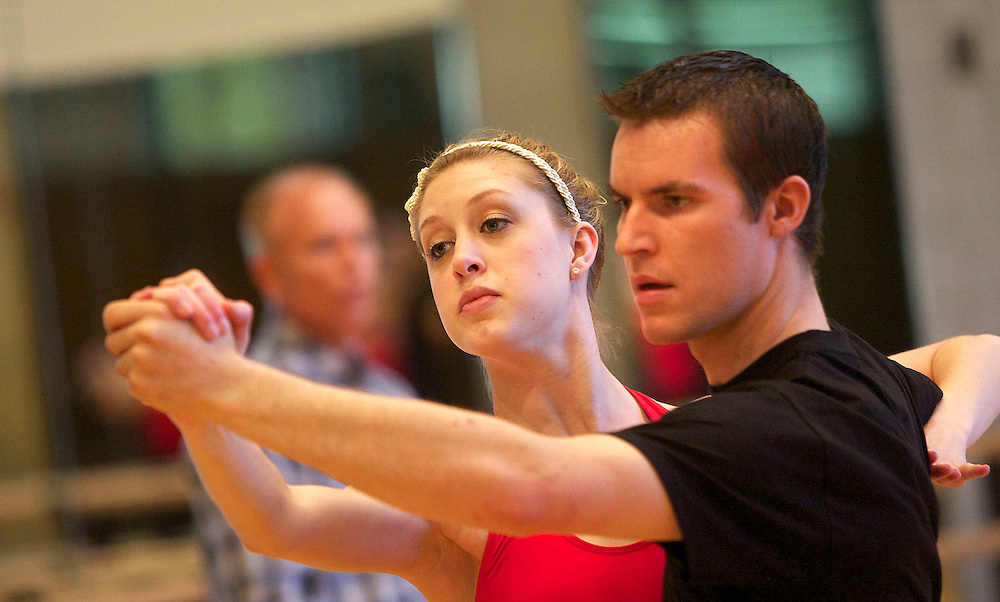 """Jamie Butler and her partner Joe Pettersson (cq), both of Orem along with other members of the Utah Valley University ballroom dance team practice for a live appearance on the popular ABC show """"Dancing with the Stars"""" on Tuesday. The practice was held at UVU in Orem, Utah, Saturday, May 15, 2010 . August Miller, Deseret News ."""