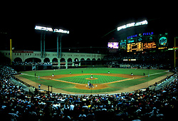 Stock photo of the interior of Enron Field (now Minute Maid Park) during a night Astros bseball game