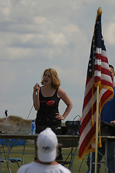 14 August 2004   Singing of the United States of America's National Anthem.  Twin City Storm V Capitol City Outlaws, Midwest Football League, Interstate Center, Bloomington-Normal IL