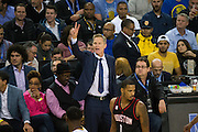 Golden State Warriors head coach Steve Kerr coaches from the sidelines against the Houston Rockets at Oracle Arena in Oakland, Calif., on December 1, 2016. (Stan Olszewski/Special to S.F. Examiner)