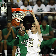 Central Florida forward P.J. Gaynor (21) slam dunks the ball during a Conference USA NCAA basketball game between the Marshall Thundering Herd and the Central Florida Knights at the UCF Arena on January 5, 2011 in Orlando, Florida. Central Florida won the game 65-58 and extended their record to 14-0.  (AP Photo/Alex Menendez)