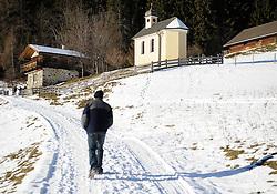 THEMENBILD - Winter Wanderung von Lienz zum Reiter Kirchl welches sich ueber Leisach auf 1130 m Seehoehe befindet, das Bild wurde am 25. Dezember 2011 aufgebommen, im Bild Wanderer kurz vor Reiter Kirchl, AUT, EXPA Pictures © 2011, PhotoCredit: EXPA/ M. Gruber