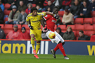 Ryan Mendes of Nottingham Forest and Mouhamadou-Naby Sarr of Charlton Athletic (r) compete for the ball. Skybet football league championship match, Charlton Athletic v Nottingham Forest at The Valley  in London on Saturday 2nd January 2016.<br /> pic by John Patrick Fletcher, Andrew Orchard sports photography.