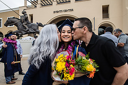 April 30, 2019 - Riverside, California, U.S. - Graduate Morgan Santana, center, gets kisses from mom, Noreen, and dad, Charlie after the Cal Baptist University commencement ceremony for the College of Engineering, College of Health Science and School of Education in Riverside on Tuesday morning, April 30, 2019. (Credit Image: © Watchara Phomicinda/SCNG via ZUMA Wire)
