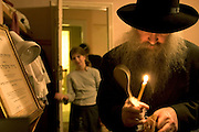 Rabbi Gluck searching for homets at the beginning of Passover. After the house is cleaned from top to bottom the children in the house hide 10 parcels of homets (bread crumbs) for the man of the house to find. The tools used to search for homets are a feather to brush up the homets, a spoon to collect them and a candle to search with. A prayer is read while carrying this out. When all the homets are collected they are burnt with everything else in the house that contains yeast.
