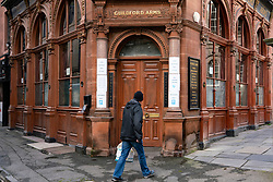 Edinburgh, Scotland, UK. 28 October 2020. Exterior of historic Guildford Arms bar in Edinburgh which has closed. Bars and restaurants in the central belt of Scotland have been forced to close by the Scottish Government during a prolonged circuit breaker lockdown.  Iain Masterton/Alamy Live News