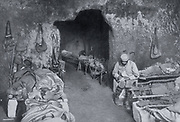 World War I 1914-1918: French soldiers resting in a grotto in a trench complex. Most are sleeping on improvised beds and one is writing a letter.   From 'Le Flambeau', Paris, September 1915.