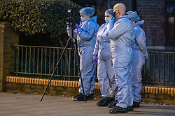 © Licensed to London News Pictures. 09/03/2021. London, UK. Forensic investigators inside a cordon after Metropolitan Police closed off Poynders Road in what is believed to be connected to the search for missing person Sarah Everard. Photo credit: Peter Manning/LNP