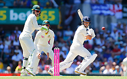 England's Tom Curran plays a shot as Tim Paine looks on during day two of the Ashes Test match at Sydney Cricket Ground.