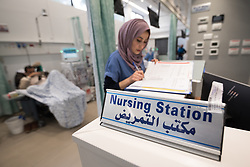 24 February 2020, Jerusalem: Nurse Hiba Almu'ti takes notes at the nursing station in the Adult Dialysis section of Augusta Victoria Hospital.