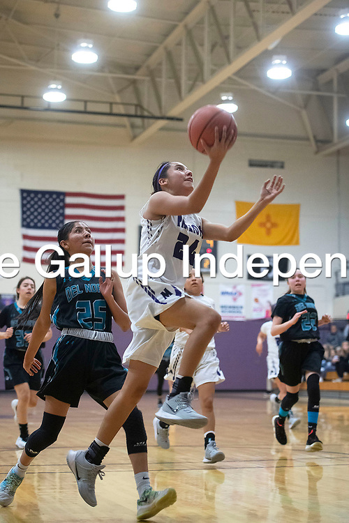 Miyamura's Gannon Lee (24) drives to the basket for a layup Friday night against Del Norte at Miyamura High School in Gallup.