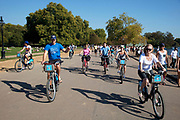 People out walking cycling and skating along Serpentine Road, enjoying the unseasonally hot weather as a summertime heat wave hits London and the UK in what should be Autumn. Summer prolonged in a heatwave which results in a packed Hyde Park as families and friends try to soak up the last rays of sunshine and warmth in this Indian Summer.
