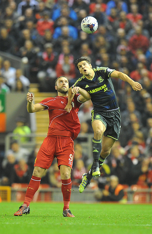 Liverpool's Rickie Lambert and Middlesbrough's George Friend jump for the ball<br /> <br /> Photographer Dave Howarth/CameraSport<br /> <br /> Football - Capital One Cup Third Round - Liverpool v Middlesbrough - Tuesday 23rd September 2014 - Anfield - Liverpool<br />  <br /> © CameraSport - 43 Linden Ave. Countesthorpe. Leicester. England. LE8 5PG - Tel: +44 (0) 116 277 4147 - admin@camerasport.com - www.camerasport.com