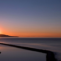 Sunrise Over the Sea Wall Dana Point California