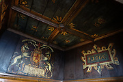 """In the Royal Palace of Edinburgh Castle, the King's Birth Chamber is where the first king of Scotland, England, and Ireland was born, James VI. In 1617 the room was painted to commemorate his birth. James VI and I (James Charles Stuart 1566–1625) was King of Scotland as James VI from 24 July 1567 and King of England and Ireland as James I from the union of the Scottish and English crowns on 24 March 1603 until his death in 1625. The kingdoms of Scotland and England were individual sovereign states, with their own parliaments, judiciary, and laws, though both were ruled by James in personal union. James was the son of Mary, Queen of Scots, and a great-great-grandson of Henry VII, King of England and Lord of Ireland, positioning him to eventually accede to all three thrones. James succeeded to the Scottish throne at the age of thirteen months, after his mother Mary was compelled to abdicate in his favor. In Celtic mythology the unicorn symbolized purity, innocence, masculinity and power. The proud, haughty unicorn was chosen as Scotland's national animal because it would rather die than be captured, just as Scots would fight to remain sovereign and unconquered. The unicorn was first used on the Scottish royal coat of arms by William I in the 1100s. Two unicorns supported the shield until 1603, when James VI replaced one unicorn with the national animal of England, the lion, to demonstrate unity. Scotland's unicorn in the coat of arms is always bounded by a golden chain, symbolizing the power of the Scottish kings, strong enough to tame a unicorn. The Scottish motto """"Nemo me impune lacessit,"""" means """"No one wounds (touches) me with impunity."""" Edinburgh is the capital city of Scotland, in the United Kingdom, Europe."""
