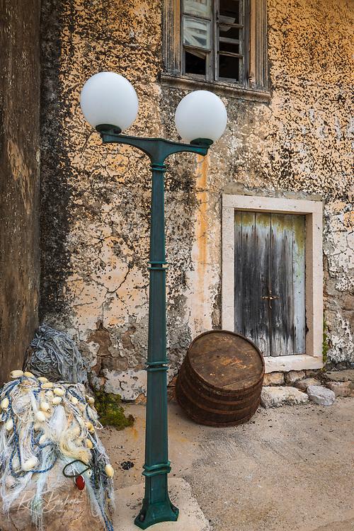 Street lamp and fishing net, Sudurad, Sipan Island, Dalmatian Coast, Croatia