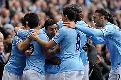 Manchester City's Jesus Navas celebrates with his team mates after scoring. - Photo mandatory by-line: Dougie Allward/JMP - Tel: Mobile: 07966 386802 24/11/2013 - SPORT - Football - Manchester - Etihad Stadium - Manchester City v Tottenham Hotspur - Barclays Premier League