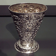 Betel holder, Batavia (now Jakarta), c.1700-1725, silver.  Betel was a widespread stimulant chewed in Asia, one also used by Europeans.  Offering a betel chewing quid to others was an integral part of social occasions.  Magnificent boxes and silver receptacles were made in which to preserve the ingredients - including betel leaves - for rolling a quid.